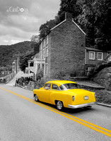 black and white photo with yellow vintage car cruising down the road at Harpers Ferry Virginia