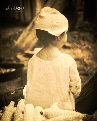 sepia tone fine art photograph of little girl in colonial attire at Claude Moore Farm Virginia