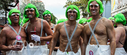 Photograph of Men with No Shirts, Green Wigs, Bushy White Eyebrows and Suspenders Key West Fantasy Fest 2009
