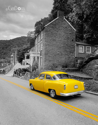 black and white fine art photograph of yellow vintage car cruising down the road at Harpers Ferry Virginia