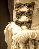 bows a sepia tone fine art image of colonial attire with bows and gloved hands