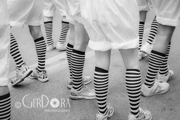 Fine Art Black and White Photograph of Legs with White Knee Socks with Black Stripes